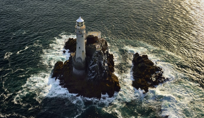The Fastnet lighthouse in west Cork Ireland from the air just after sunrise