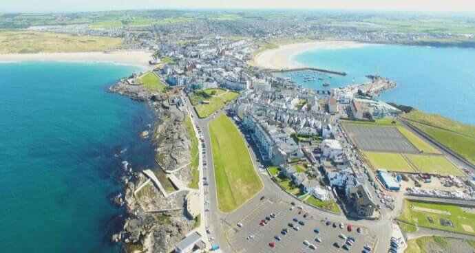 aerial shot of west strand beach in portrush ireland