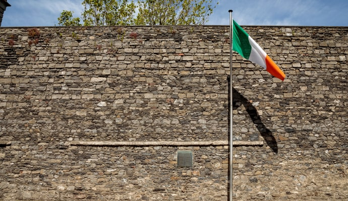 photo of irish flag in front of wall