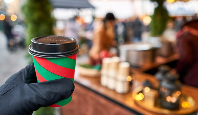 Hand holding a cup of mulled wine at the Dun Laoghaire Christmas market