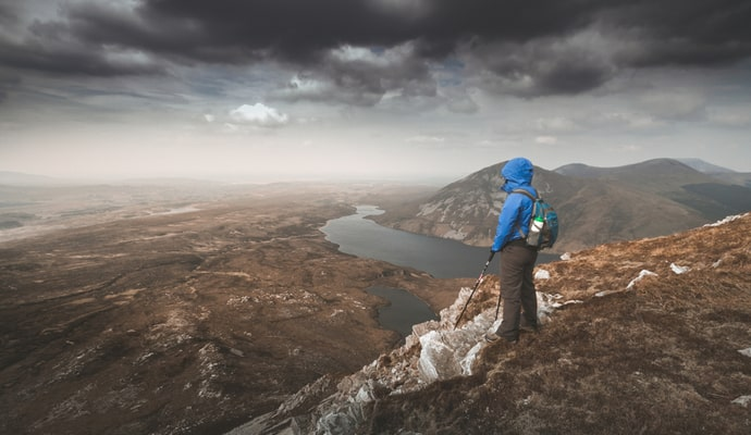 Woman looking at the horizon at Mount Errigal